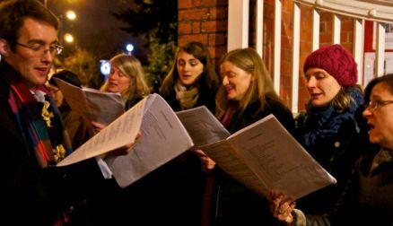 Christmas night - carols at church door