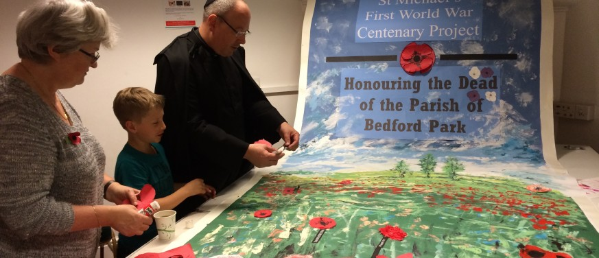 remembrance-putting-poppies-on-banner-img_2865